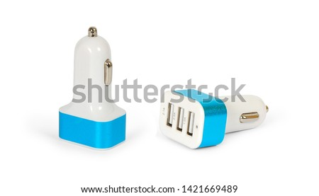 Set of USB car charger in cigarette lighter isolated on a white background. Full depth of field. #1421669489