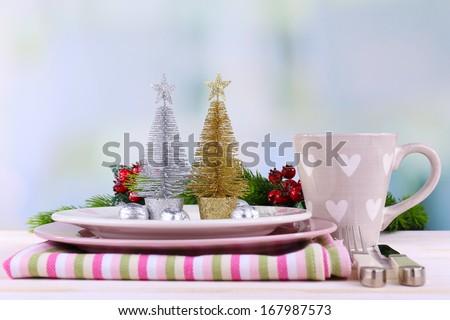 Set of utensil for Christmas dinner, on table, on light background