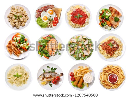 Photo of  set of various plates of food isolated on white background, top view
