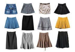 Set of various skirts on white background