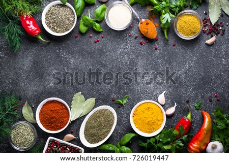 Set of Various spices and herbs in a bowls on black stone table. Top view with copy space. - Shutterstock ID 726019447