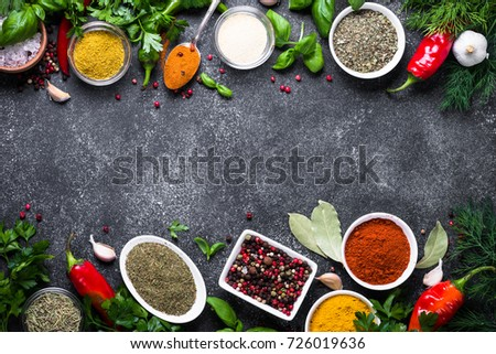 Set of Various spices and herbs on black stone table. Top view with copy space. Food background. - Shutterstock ID 726019636