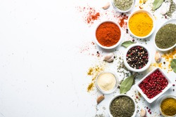 Set of various spices in a bowls on white background. Top view copy space.