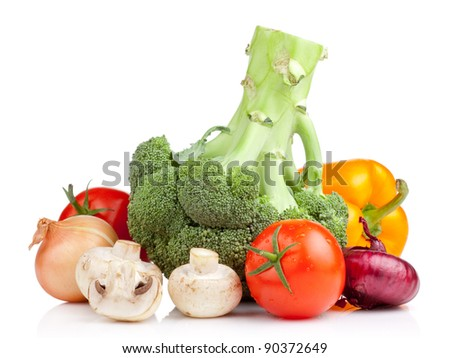 Set of vegetables: Broccoli, tomatoes, onions, garlic, parsley, mushrooms and yellow pepper isolated on white background