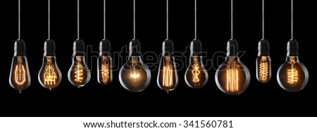 Photo of  Set of vintage glowing light bulbs on black background