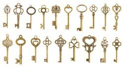 Set of vintage golden skeleton keys isolated on white background