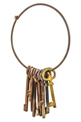 Set of vintage rusty keys hanging on a ring isolated on a white background