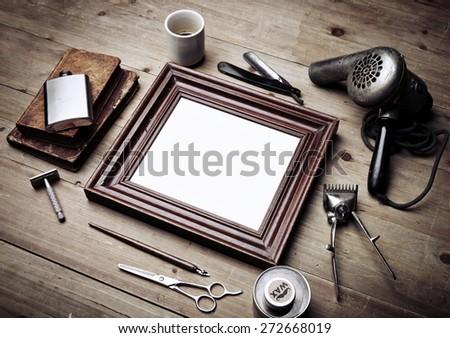 Set of vintage tools of barber shop and black picture frame