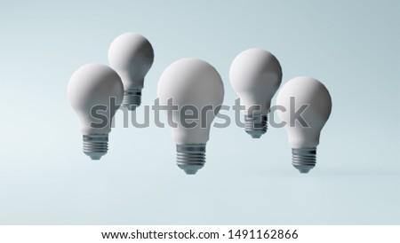 Set of white bulb lamps on a blue pastel color background. Idea concept. Innovation concept