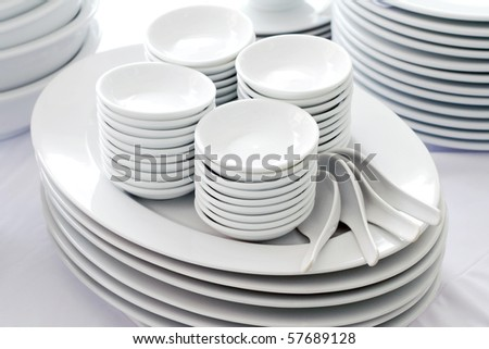 set of white dishes ,spoon and bowl
