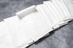 Set of white paper bubble envelopes for postal shipping
