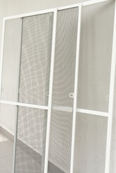 Set of window mosquito nets, close up view. Reliable protection against mosquitoes, flies, and insects.