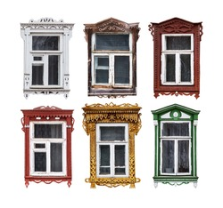Set of windows with the wooden carved architrave in the house in the old Russian town. Isolated on the white.