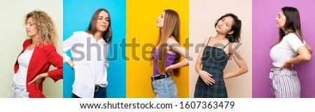 Set of women over isolated colorful background suffering from backache for having made an effort