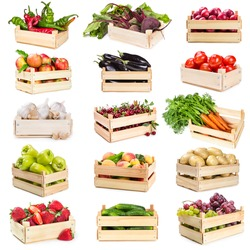 Set of wooden boxes with vegetables, fruits and berries isolated on white background