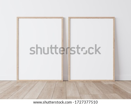 Set of 2 Wooden frames a3,a4, frame mock up on white wall standing on wooden floor. Poster mock up. minimal frames. Empty frame Indoor , 3D render, 3D illustration