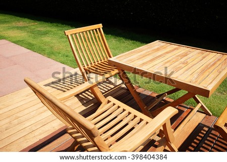 Set of wooden table and chairs in the garden #398404384