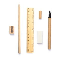 Set of wooden writing tools, pencil, pen, ruler, eraser and sharpener, isolated on white background