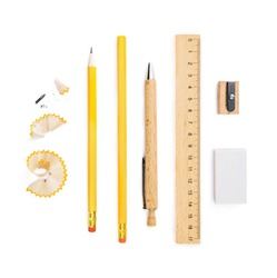 Set of wooden writing tools, pencil, wooden pen, ruler, sharpener, pencil shavings and eraser, isolated on white background