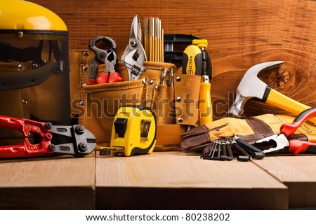 set of working tools on wooden boards