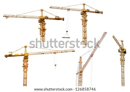 set of yellow hoisting cranes isolate on white background
