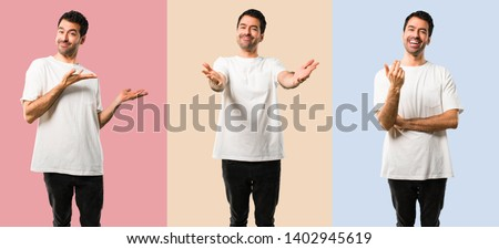 Set of Young man with white shirt presenting and inviting to come with hand. Happy that you came on colorful background #1402945619