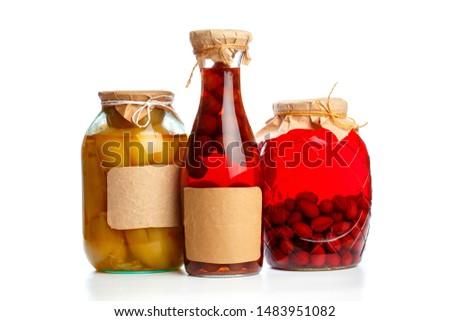 set og  glass bottles with preserved food on white background - Image