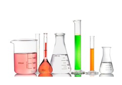Set or Collection of  chemical glassware filled by different colors isolated on white background.