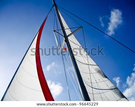Set sails against a beautiful blue sky