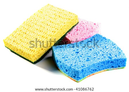 Set scourers for ware washing pink, blue and yellow on a white background.