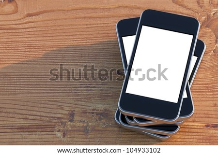 set smartphones with touch screen technology on wooden surface (right composition version)
