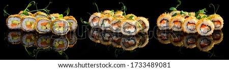 Set tempura maki sushi rolls fries - japanese food style. Hot fried Sushi Roll. Sushi menu. Japanese food. Hot fried Sushi Roll