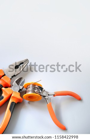 set tools. wire cutters, pliers on gray background. Set of Pliers, Side cutter, Combination pliers, Needle pliers. Basic tool of worker.