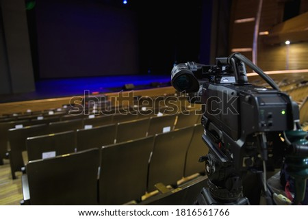 Set up and preparation video camera before the event at stage theater or concert hall for professional photographer filming video or television broadcasts with empty stage on background   Stockfoto ©