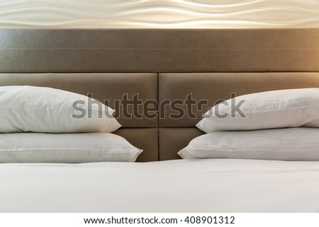 Set up brown bed with white linen in a hotel closeup #408901312