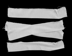 Set white adhesive bandage isolated on black background, top view
