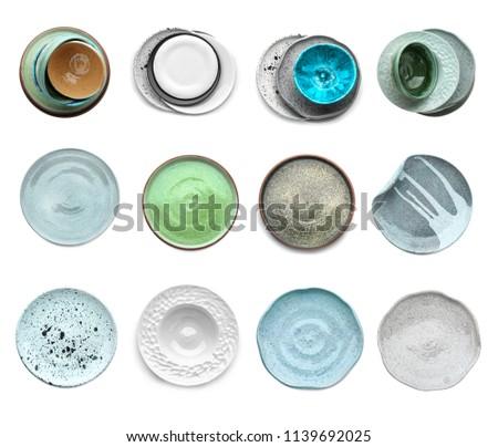 Set with beautiful ceramic dishware on white background #1139692025