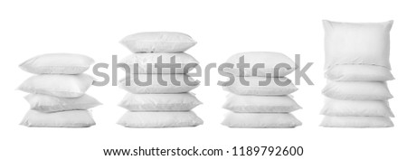 Set with bed pillows on white background