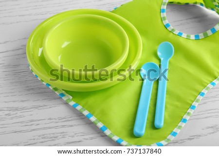 Set with bright baby dishware on table #737137840