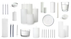 Set with different decorative wax candles on white background
