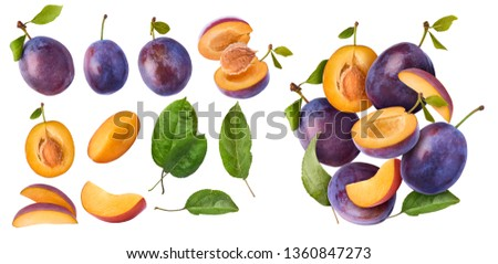 Set with different Flying in air fresh ripe whole and cut Plums with leavs isolated on white background. High resolution image Foto stock ©