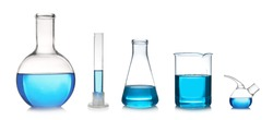 Set with different laboratory glassware and liquid for analysis on white background