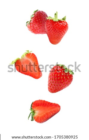 Set with falling sweet strawberries on white background