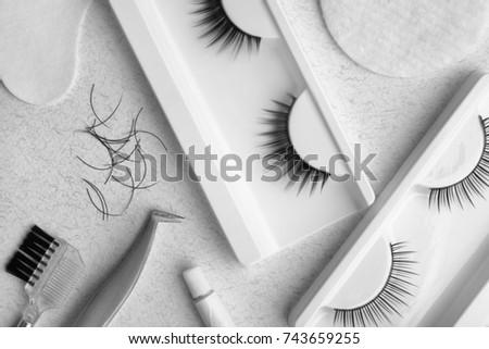 Set with false eyelashes on light background