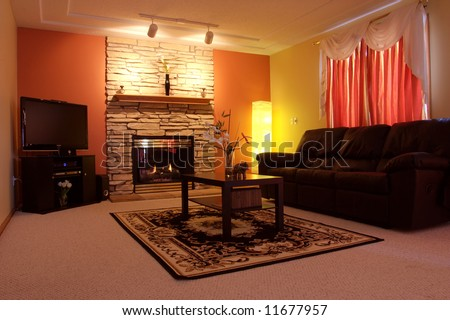 Set with nice ambient lighting this family room offers comfortable place for the family