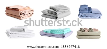 Set with stacks of clean bed linen on white background. Banner design Photo stock ©