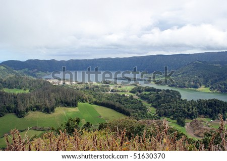 Sete Cidades and the two lakes Lagoa Azul and Lagoa Verde in the volcanic crater at the island of Sao Miguel which is a part of the Azores