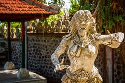 Setesuyara is the goddess of the underworld, along with Batara Kala, in traditional Balinese mythology. Stone figure of balinese god. Water Palace of Tirta Gangga in East Bali, Indonesia.