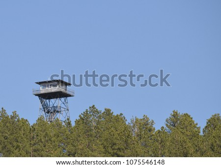 Seth Bullock Fire Lookout Tower from a distance with room for text