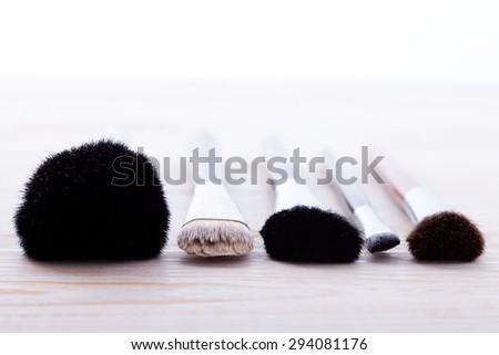 Sets makeup brush for professional makeup artist. Selective focus, macro shooting